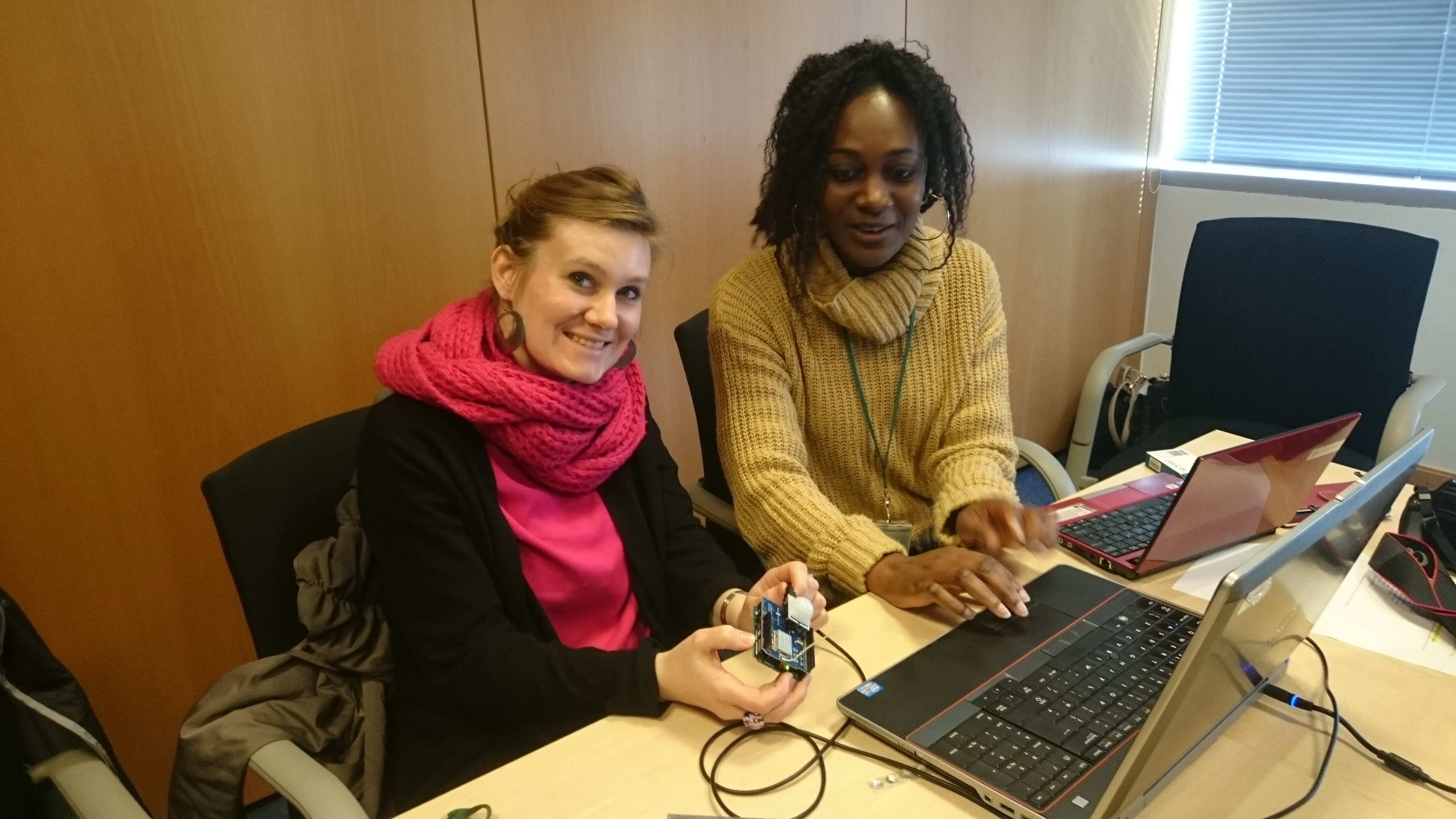 Two women showing their first IoT devices