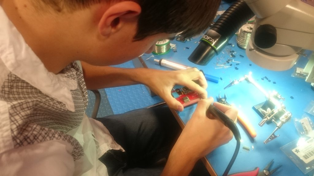 Tom beavering away with the soldering station