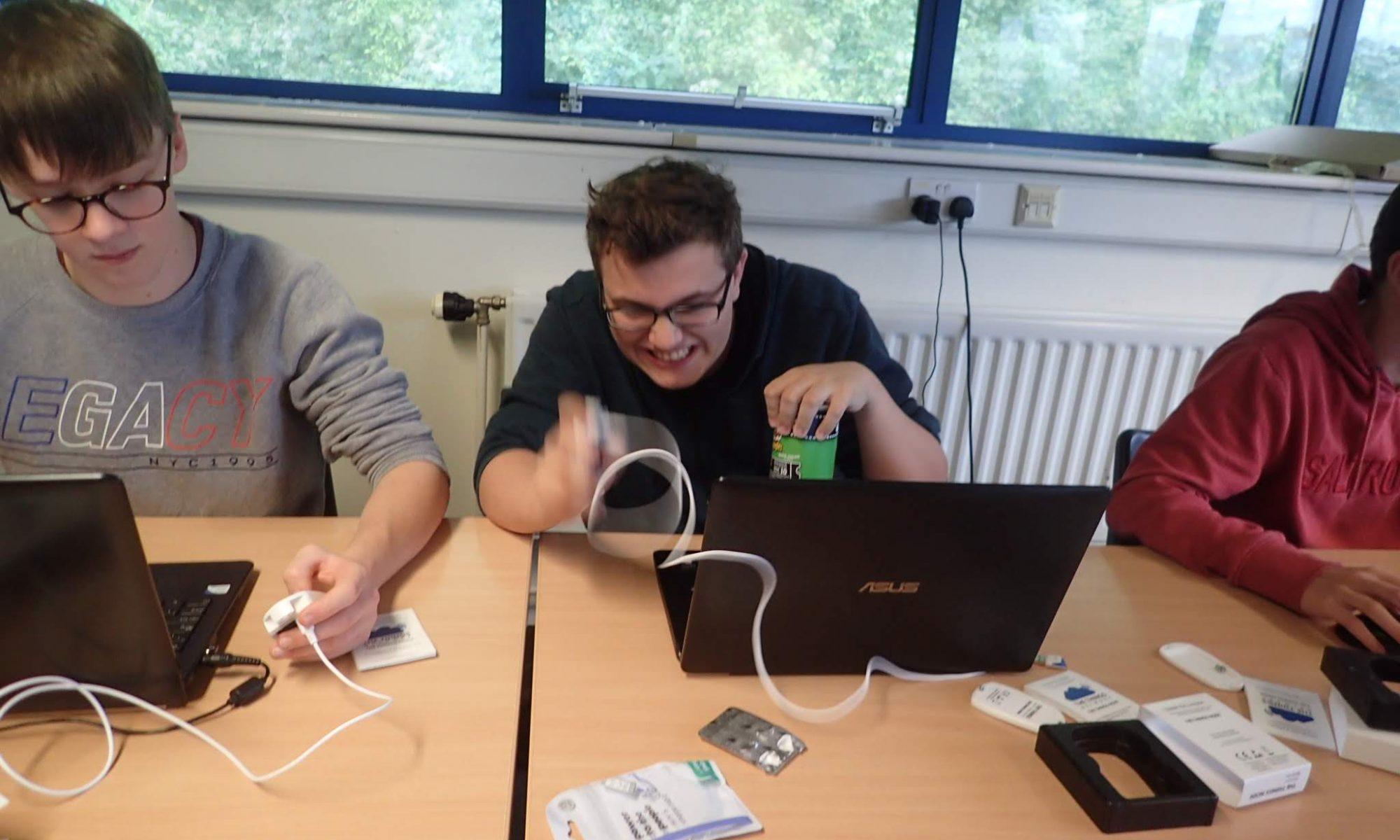 Student vigorously shaking a motion sensor